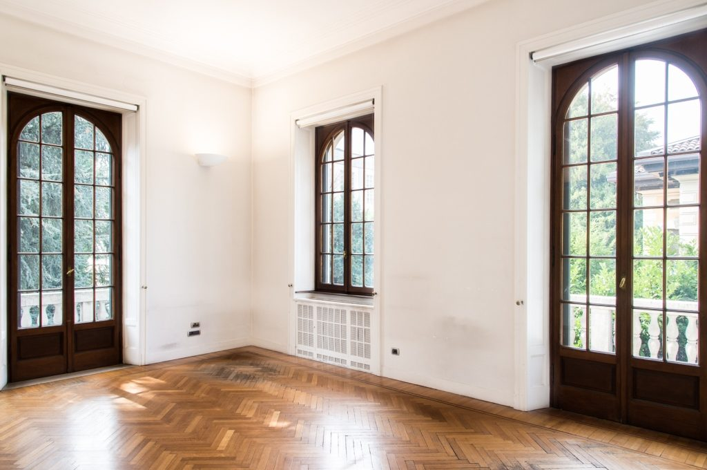 wide room with wooden floors